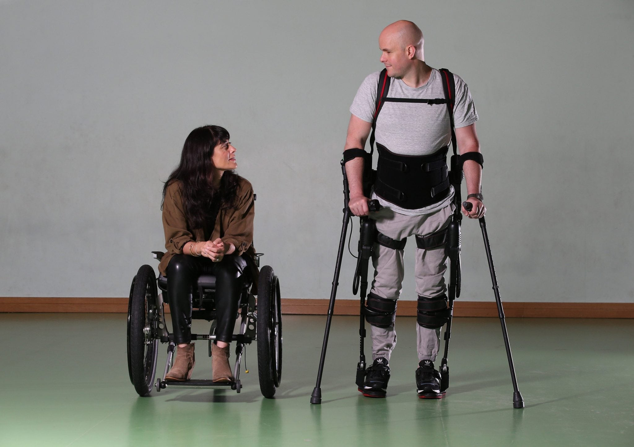 ALL IMAGES COPYRIGHT MARK POLLOCK TRUST. Mark Pollock wears the Ekso Bionics robotic exoskeleton as Simone George sits his his wheelchair at Trinity College in Dublin 7th November 2015. Photographed by Peter Macdiarmid for the Mark Pollock Trust.