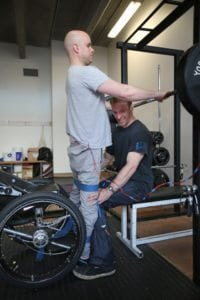 ALL IMAGES COPYRIGHT MARK POLLOCK TRUST. Mark Pollock stands as his spine is electrically stimulated with the assistance of his trainer Simon O'Donnell in the gym at Trinity College in Dublin 7th November 2015. Photographed by Peter Macdiarmid for the Mark Pollock Trust.