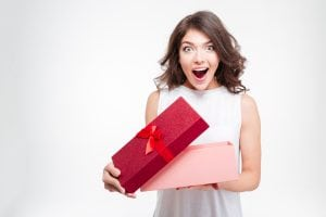Smiling Happy Excited Woman Opening Present Gift